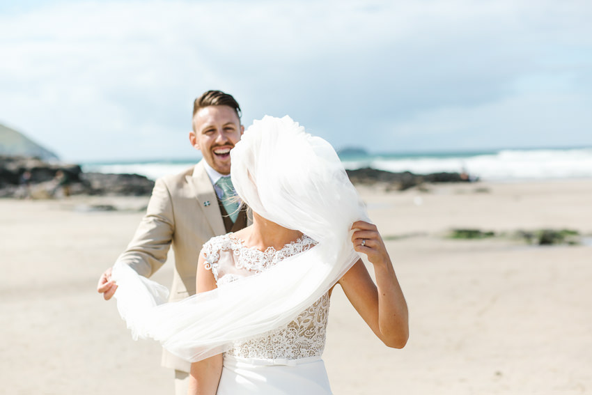 Bride, groom, veil, beach, cornwall