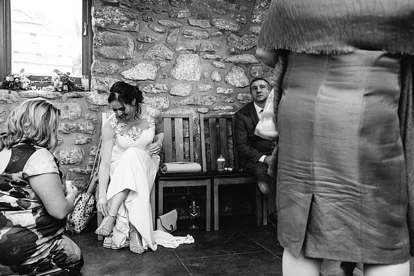 bride changing shoes at wedding